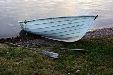 boat and oars on the lake
