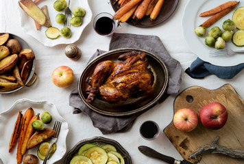 Big festive dinner with roasted chicken and various garnishing. Overhead view, celebration concept
