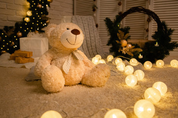 teddy bear on the background of Christmas decorations