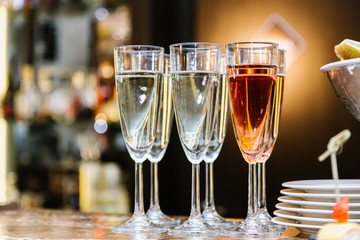 Glasses with champagne are on the bar