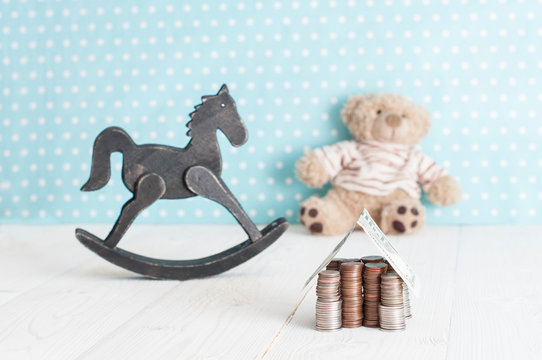 toy horse, teddy bear and money house