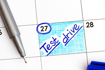 Reminder Test Drive in calendar with blue pen.