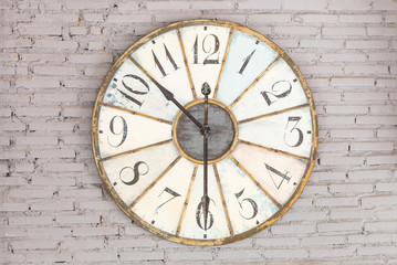 Retro clock showing ten thirty on the wall