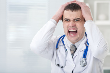 Portrait of male doctor having  stress