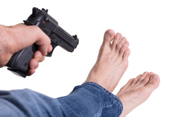 Man shooting himself in the foot