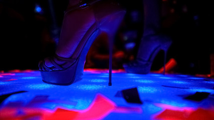 High heels of professional go-go dancer performing at nightclub, close-up