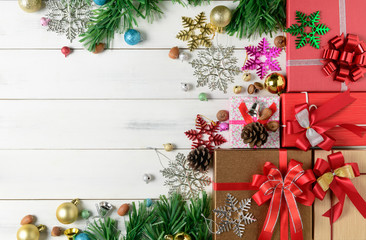 Christmas presents with decorations on white wooden