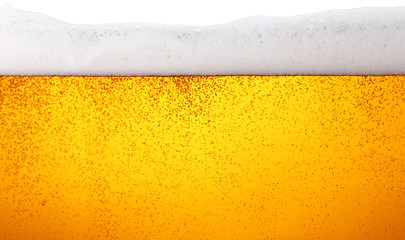Close up background of beer with bubbles in glass Wall mural