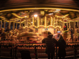 Parents watching the merry-go-round.