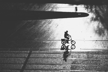 aerial view of biker silhouette - street scene - contrast black and white Nantes, FRANCE - NOVEMBER 2018