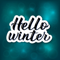 Hello Winter hand drawn on bright blue background with bokeh. Calligraphy brush lettering. Holidays mood vector illustration. Easy to edit template