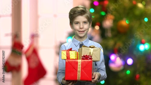 Portrait of cute young man with Christmas gifts. Handsome caucasian boy giving gift boxes on abstract Christmas background. Merry Christmas concept.  sc 1 st  Fotolia.com & Portrait of cute young man with Christmas gifts. Handsome caucasian ...