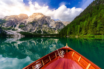 Lake Braies (also known as Pragser Wildsee or Lago di Braies) in Dolomites Mountains, Sudtirol, Italy. Romantic place with typical wooden boats on the alpine lake.  Hiking travel and adventure. 壁紙(ウォールミューラル)