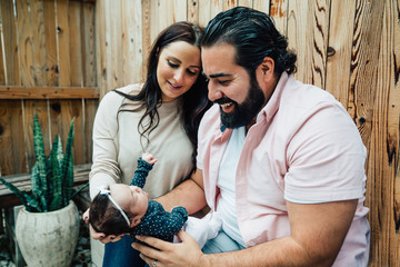 Parents bonding with newborn baby