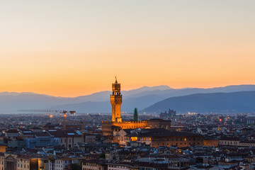 Sunset over the city of Florence with Palazzo Vecchio