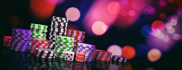 Poker chips piles and dice on abstract bokeh background, banner, copy space. 3d illustration