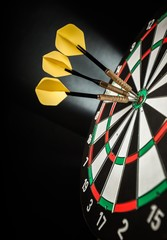 Closeup of Darts in Bullseye