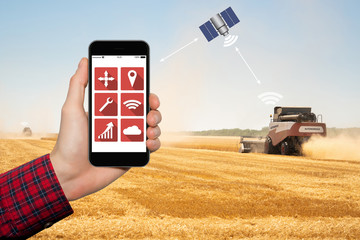 Wall Mural - Control of autonomous harvesters by satellite communication. Smart farming concept