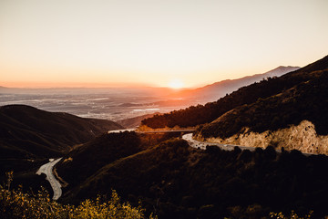 Winding roads on mountains during sunset