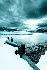 Snow covered dock on a cloudy day