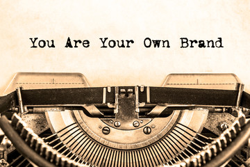 the word you Are your Own Brand printed on a vintage typewriter.