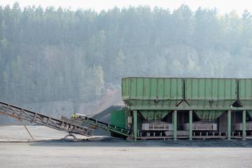 Stone crusher machine in a open pit mine. Porphyry rock.