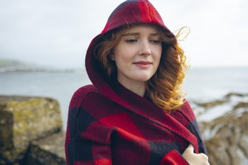 Redhead woman standing in the beach