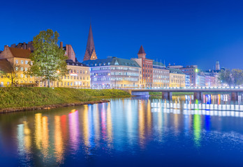 Night city view. Cityscape of Malmo at the evening, Sweden. Beautiful European town reflected in water
