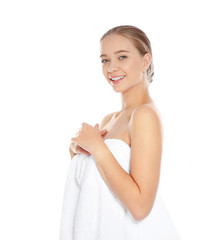 Portrait of young pretty woman with towel on white background