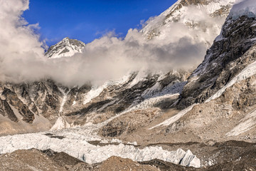 Khumbutse peak coming out of clouds over Khumbu Glacier in Nepal near Everest Base camp.