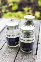 Jars of indigo leaves and color dye