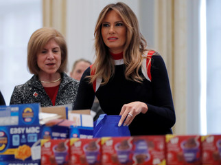 First lady Melania Trump fills care packages for service members at American Red Cross in Washington