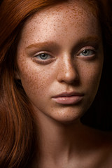 Portrait of a woman with freckles