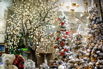 Big and beautiful decorated Christmas trees in a shop