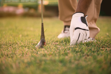 Close up hand of golfer put golf from grass,Thailand people