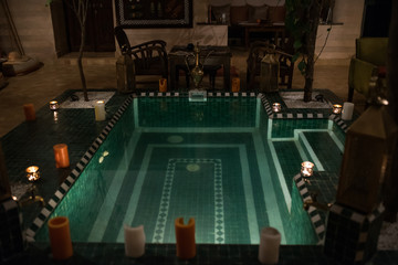Light up candles in a swimming pool in morocco