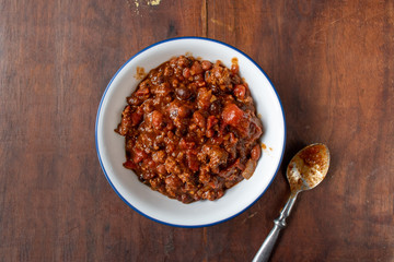 bowl of chili with beans and tomatoes flat lay