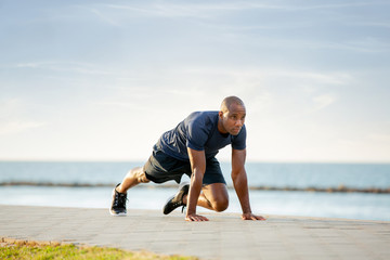 Man doing mountain climbing on the beach