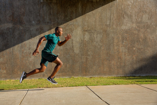 Side view of athlete running