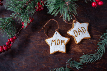hand painted Christmas star ornaments for mom and dad on festive wood table