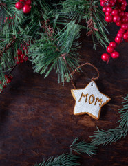 hand painted Christmas star ornaments for single mom on festive wood table