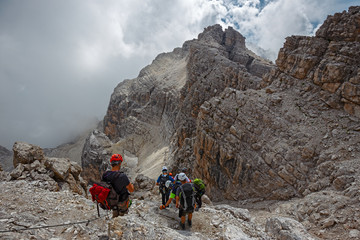 "Mountaineers equipped face the ""Bocchette Alte"" ferrata in the Brenta group on the Dolomites, in Italy"