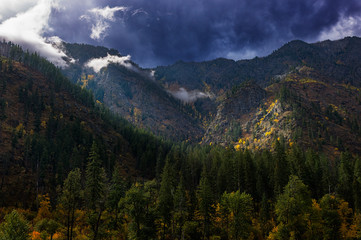 Stormy autumn sky with the sun breaking through over the mountains in North Central Washington