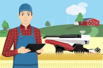 Farmer controls of autonomous harvester by tablet computer. Smart farming concept