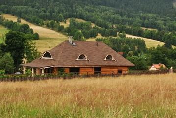 Fototapeta Drewniany dom w górach obraz