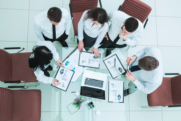 professional business team developing a new financial strategy of the company at a work location in a modern office
