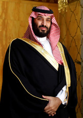 Saudi Arabia's Crown Prince Mohammed bin Salman poses for pictures during his visit in Tunis