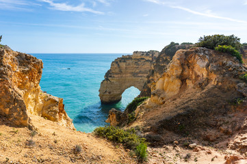 Cliffs and sea in sunny day near by Benagil Beach, Portugal, popular travel and holiday destination in Europe