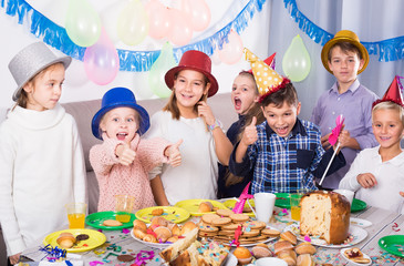 Smiling boys and girls happy to celebrate friend's birthday