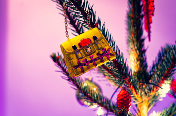 Christmas ornament in the form of a handbag on a Christmas tree and glowing lights